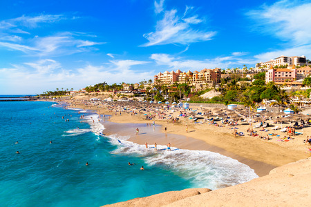 Summer holiday on El Duque beach in Tenerife, famous Adeje coast on Canary island, Spain