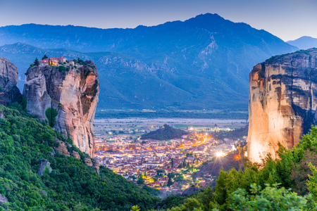 Beautiful night scene over the mountain and Holy Trinity monastery in Meteora place,  Greece, Europe Stock Photo