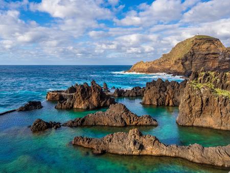 Natural swimming pools on volcanic region of Porto Moniz in Madeira island, Portugal