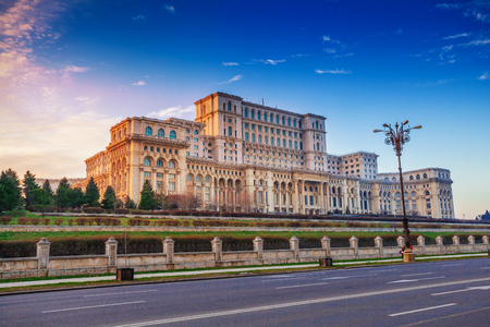 Most famous and larger building in Europe, the Parliament house of Government illuminated by sunset, in Bucharest capital, Romania