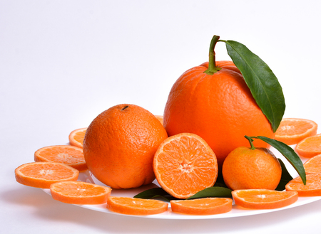 Oranges fruits on a plate