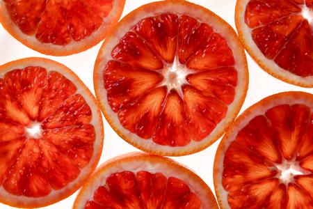 Red orange slices on white background 스톡 콘텐츠