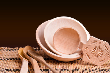 Wooden cooking tools on black background