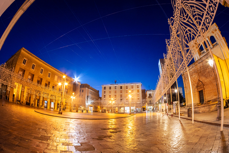 Romantic scene in Lecce city at blue hour. Traditional historic architecture in Puglia region, of Italy 스톡 콘텐츠