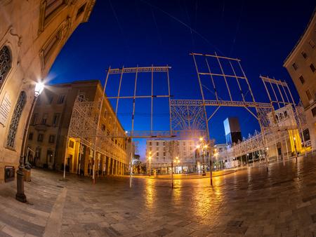 Romantic night scene in downtown of Lecce city. Cityscape with traditional architecture of Puglia region - Italy 스톡 콘텐츠