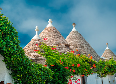Traditional house roof arhitecture of the folk Trulli village in Alberobello, Italy Stock fotó