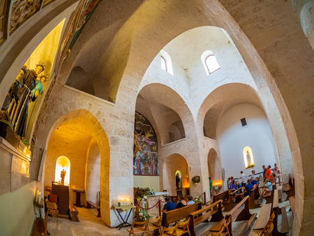 Alberobello, Italy - August 15, 2018: Tourists visiting inside of the famous architecture of Trullo-church in Trulli village of Alberobello 에디토리얼