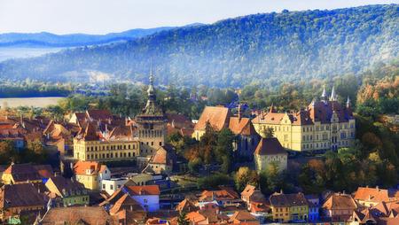 Cityscape panorama from Sighisoara in fall season, medieval citadel of Transylvania region, Romania