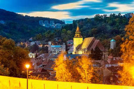Cityscape of Brasov in evening lights in fall season, Transylvania region in Romania