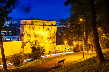 Medieval and historic architecture of the Bastion museum illuminated in evening lights, in Brasov, Transylvania - Romania 에디토리얼