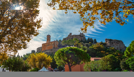 Eze cityscape and surroundings, with medieval church inside the citadel in fall season,  France