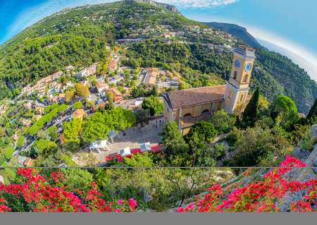 Aerial view over Eze cityscape and surroundings, with medieval church inside the citadel town, in France 新聞圖片