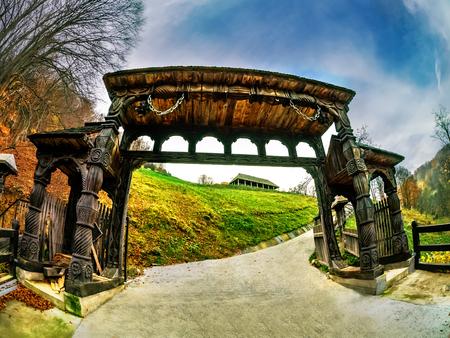 Traditional wooden gate, symbol of Maramures, in Sighetu Marmatiei, Romania 스톡 콘텐츠