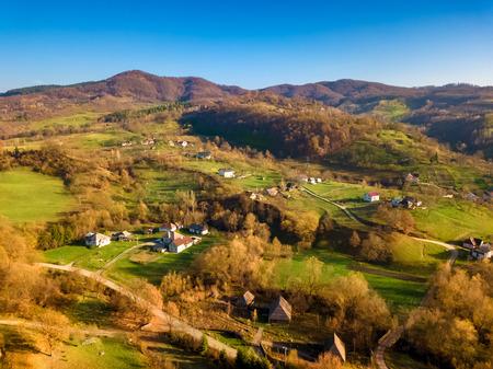Autumn aerial landscape over touristic Village of Sirnea, Fundata - Romania