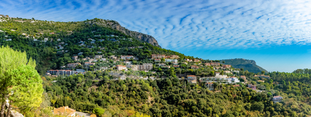 Townscape of Eze village, panoramic view over the historic house architecture on the hiil in botanical garden of France