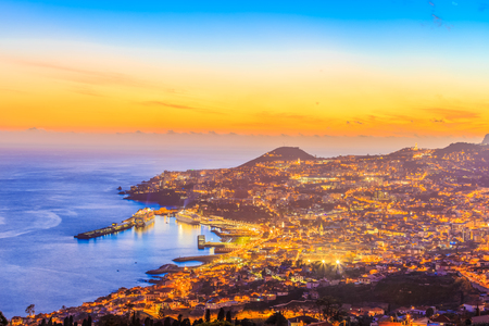 Night scene with cityscape of Funchal capital, Madeira island, Portugal 스톡 콘텐츠