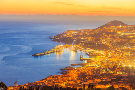 Scene of Funchal capital illuminated at twilight hour, in Madeira, Island - Portugal
