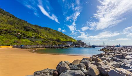 Tropical Machico bay beach on the coast of Madeira island. Tourist destination on exotic island of Portugal
