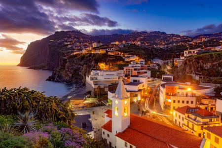 Night scene of Camare de Lobos, illuminated architecture of the town, Madeira island, Portugal 스톡 콘텐츠