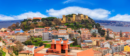 Panorama of Lisbon, cityscape and famous Sao Jorge castle in a day time, in Portugal