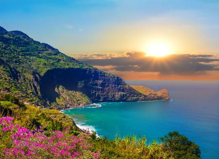 Beautiful coastline of Madeira island at sunset, seascape background - Portugal 스톡 콘텐츠