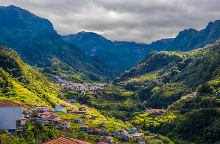 Panoramic aerial view over Lombo Galego village on mountain, in Madeira island, Portugal
