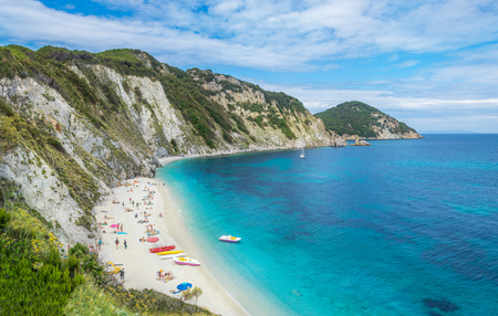 Sansone beach from the air in summertime, Italian holiday bay, relaxation and vacation place on the coast of Elba island in Italy