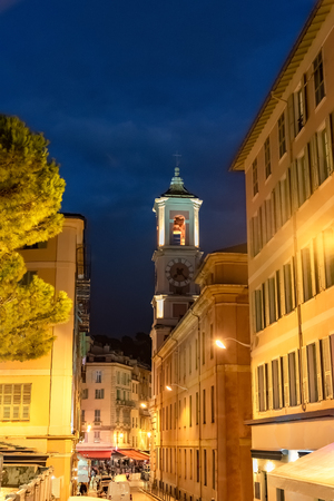 Place Rossetti on French Riviera, Tower bell with old clock of medieval cathedral in evening lights, in France
