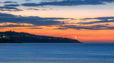 French riviera landscape, beautiful Cote d`Azur at sunrise, vibrant panorama early in the morning on the coast of France