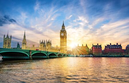 London cityscape with Big Ben and City of Westminster Abbey bridge in sunset light, in United Kingdom of England 免版税图像