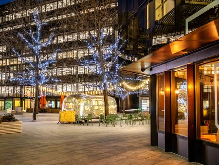 Night scene of Broadgate square illuminated in Christmas lights in the city of London, near Liverpool street in  England, UK