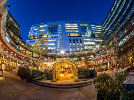 Lomndon, England, UK - December 9, 2019: Wide view of  Broadgate Circle illuminated with Christmas decorations outdoor  in winter seasonal holiday at night