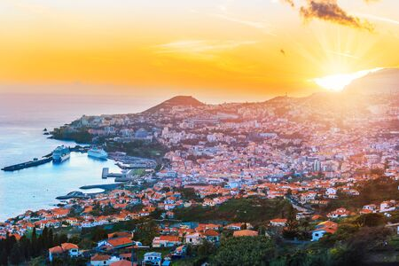 Beautiful sunset over Funchal capital in Madeira island in Portugal Imagens