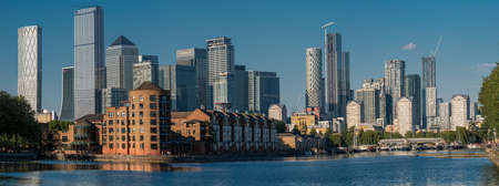 London, England, UK - Jun 2, 2020: Panoramic view of the modern buildings in the Rotherhithe area over the Thames rives in Canary Wharf, London