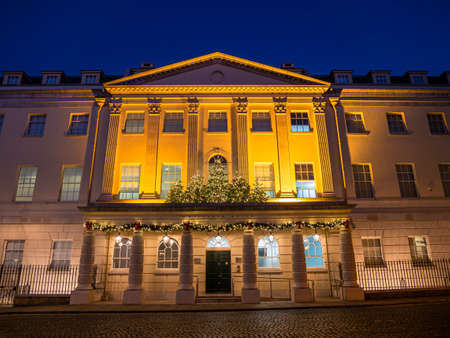 Richmond, London, United Kingdom - December 4, 2019: Famous building Whittaker House of Business Professional Consultants in Richmond Upon Thames illuminated at blue hour decorated in Christmas holiday