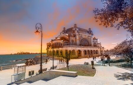 Old medieval architecture in Constanta, the famous Casino in sunset light in Romania
