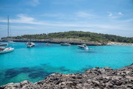 Beautiful sailing area by the sea on the coast of Mallorca island with blue and clear water in the summer season in Spain Imagens