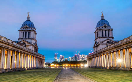 Historic Chapel architecture of St Peter and St Paul old Naval Royal College against the city of London at dusk Editorial