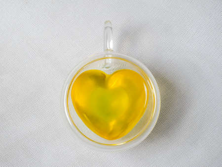 Top view of a transparent heart-shaped teacup view from above