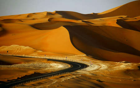 Desert road and sand dunes in Liwa, United Arab Emirates