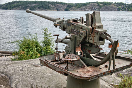 lethal: Old rusty anti aircraft gun near Stockholm, Sweden