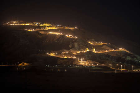 Night view of Jebel Hafeet and the lit road, Al Ain, UAE
