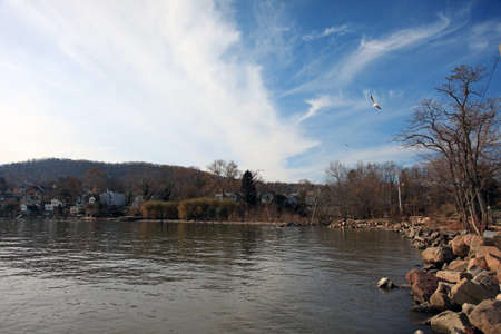 hudson: Blue sky, thin clouds over a town on Hudson river Stock Photo
