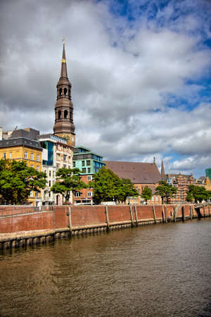 waterways: Downtown Hamburg on a cloudy day. Tourist boats passing on the waterways.