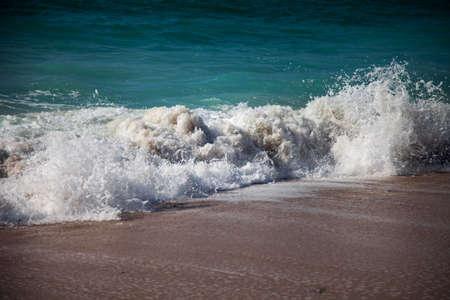 musandam: Surf breaking on the sandy beach