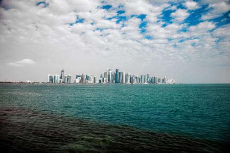 doha: Doha skyline on a cloudy day. Qatar
