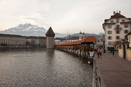 Lenticular clouds and the Chapel Bridge in Luzern (Lucerne), Switzerland