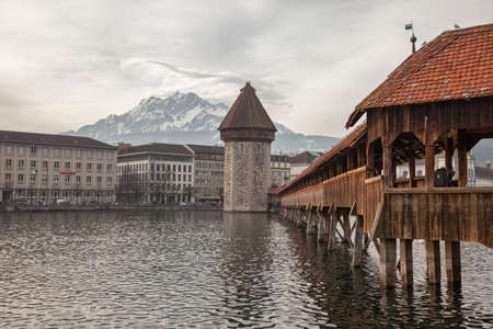 lenticular: Lenticular clouds and the Chapel Bridge in Luzern (Lucerne), Switzerland