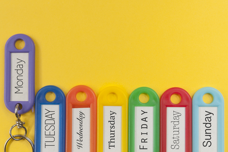 Key holders with names of the day of the week on them Stock Photo