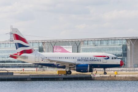 LONDON, UK - AUGUST, 2 2013; A British Airways Airbus A-318 (G-EUNB) rolls on the runway of the London City Airport in the borough of Newham before take off Editorial